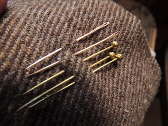 historiska nålar, brons